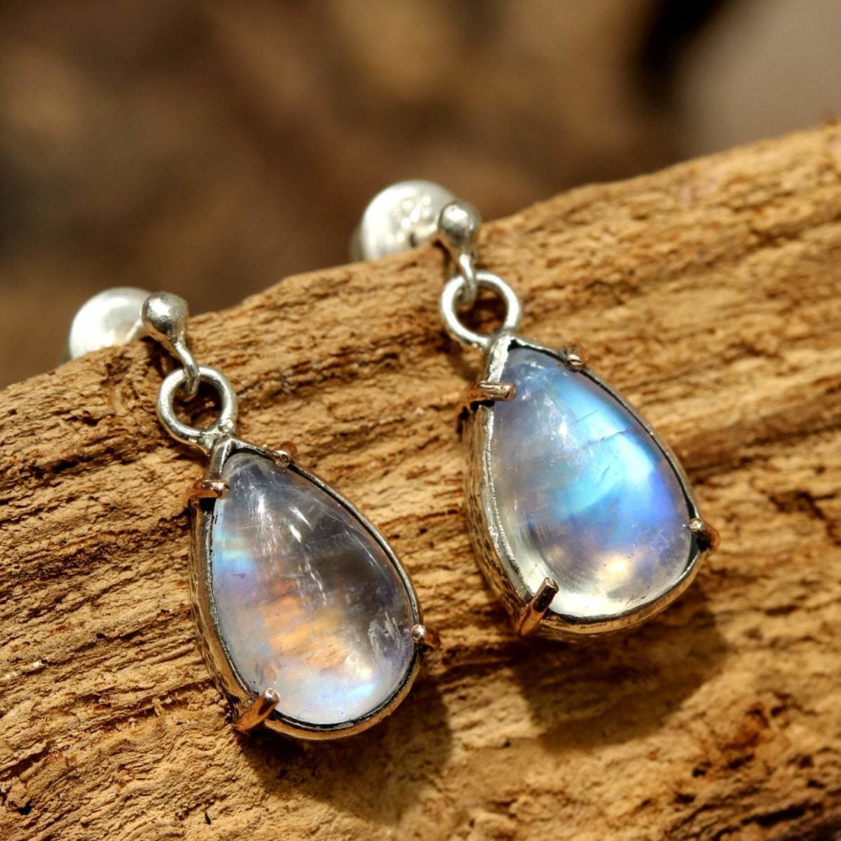 Tiny Moonstone teardrop cabochon earrings in silver bezel and rose gold prong with sterling post style - by Metal Studio Jewelry