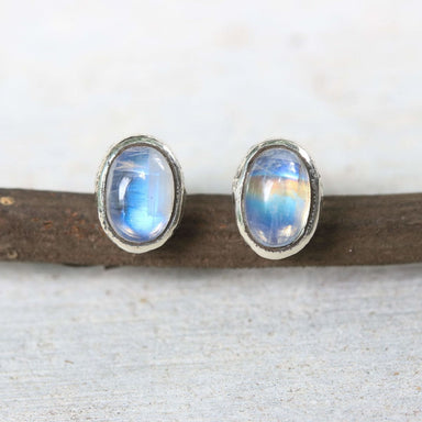 Tiny oval cabochon moonstone earrings in silver bezel setting with sterling post and backing - by Metal Studio Jewelry