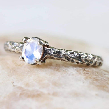 Rings Tiny oval faceted moonstone ring in silver prongs setting with sterling hard texture oxidized band