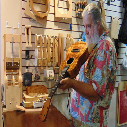 Uncle Uke of HUG Ukuleles crafting an ukulele.