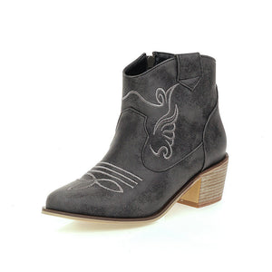 Female vintage carved thick with cowboy boots