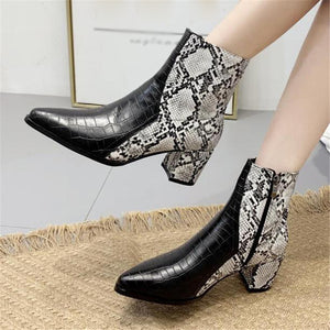 Women's boots with snake pattern and thick heel