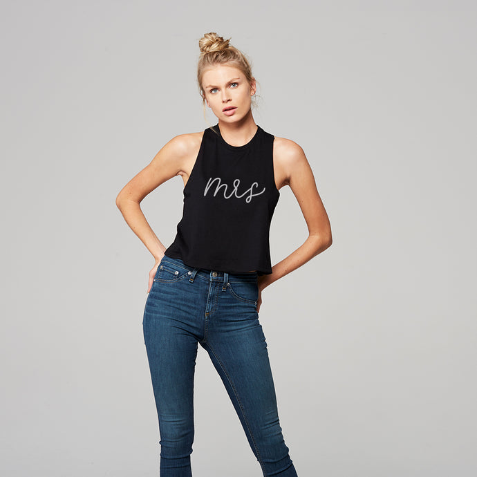 Young woman with a black crop tank with modern calligraphy font that says mrs in white