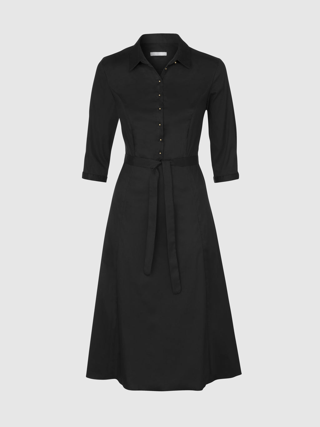 Front view of a below the knee black fitted shirt dress with gold metal shank ball buttons, a tie belt, and a 3/4 sleeve with a narrow cuff, from the RÉZO women's collection.