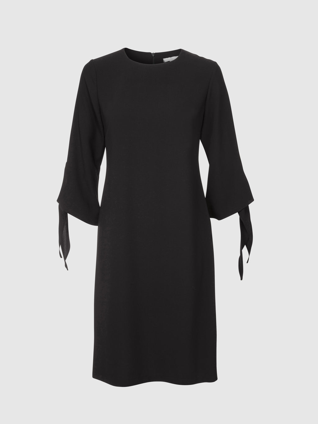 Front view of a knee length semi fitted round neck black crepe dress with a tie bell cuff shaped sleeve from the RÉZO women's collection