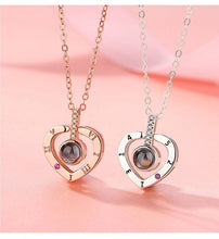 Load image into Gallery viewer, two memory of love heart necklaces in rose gold and silver
