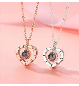 two memory of love heart necklaces in rose gold and silver