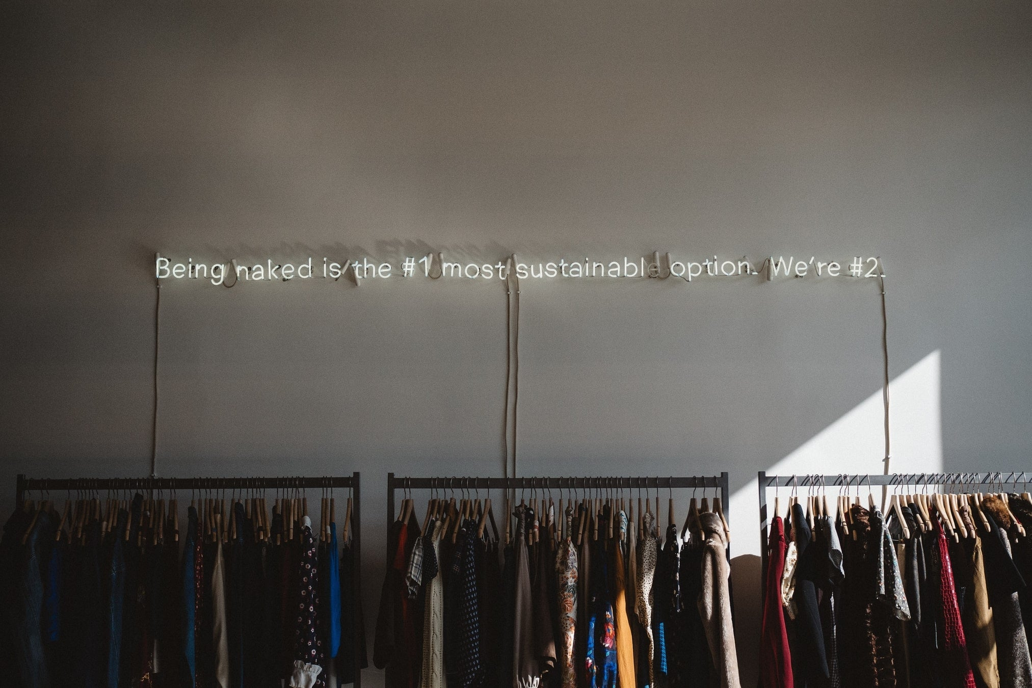 Mizo backpacks sustainable brand text displayed on the wall