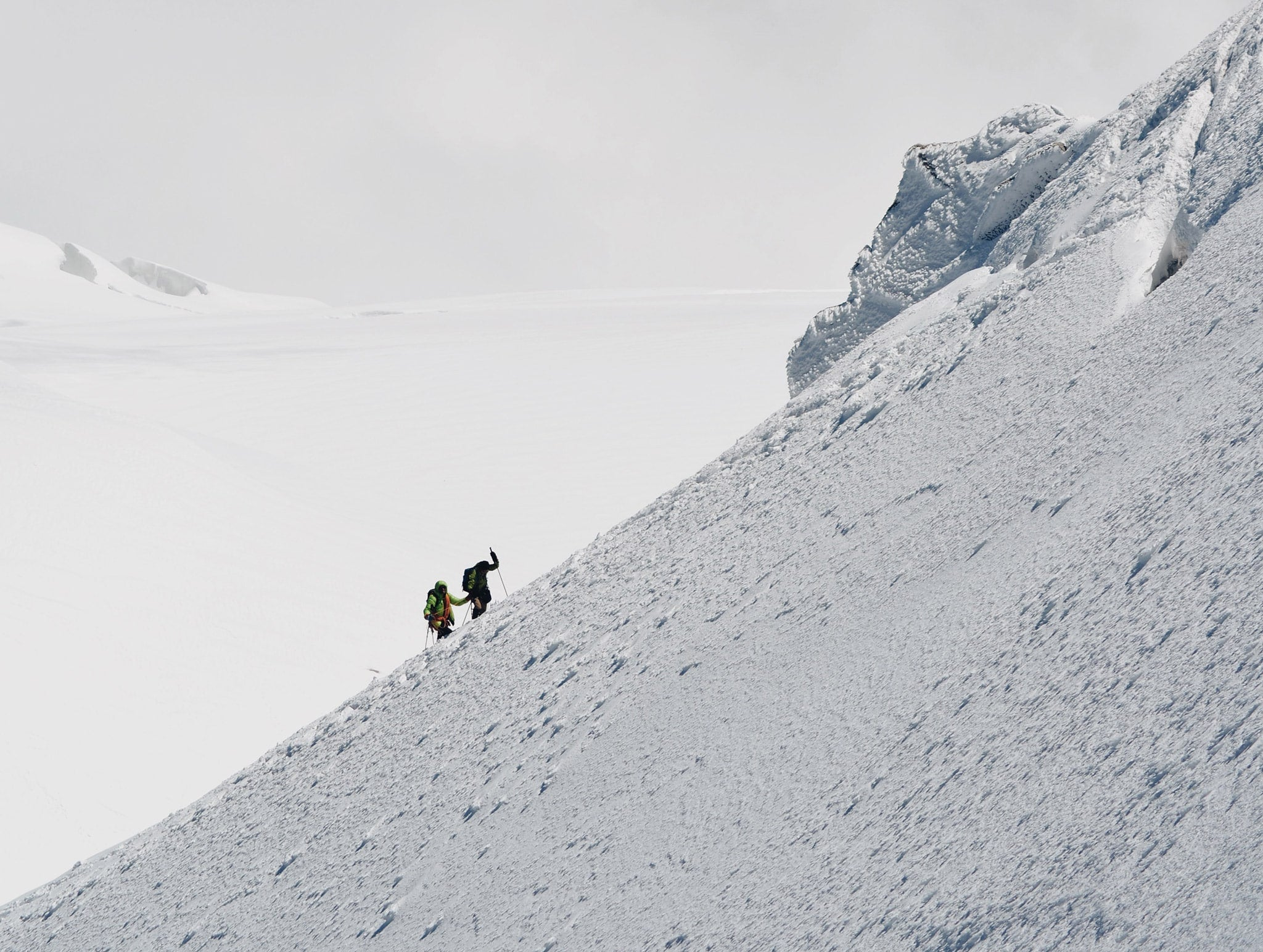 Mizo backpacks men walking on a hill with alpinism type of backpack on their shoulders