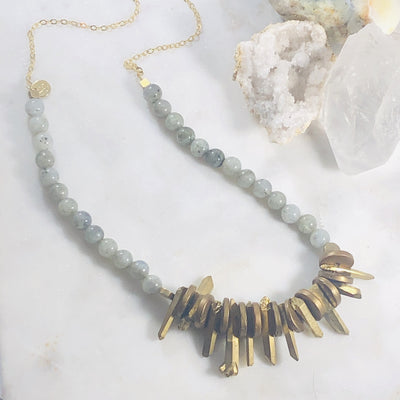 Handcrafted quartz crystal and labradorite statement necklace that's high vibe and high style