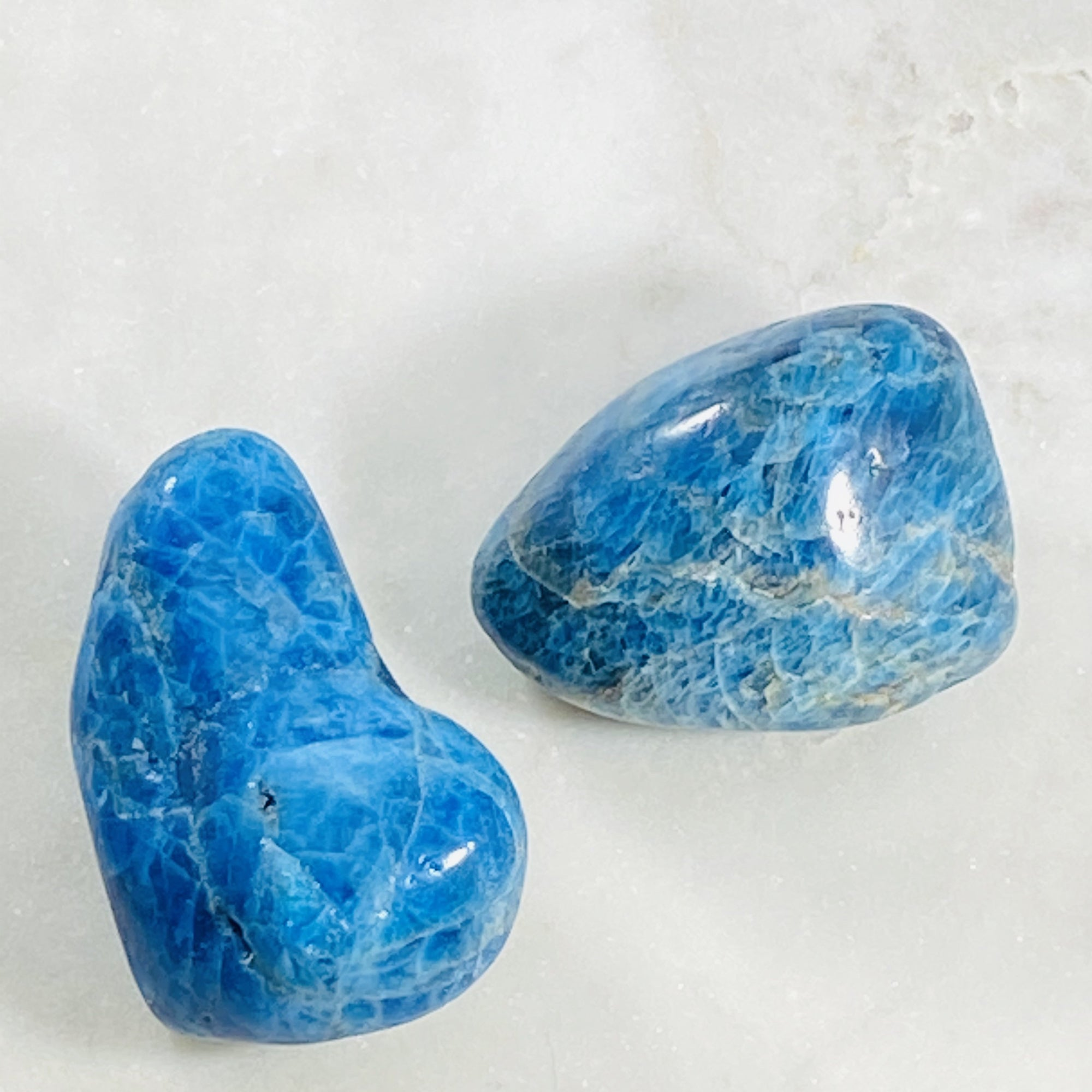 Large blue apatite healing gemstone and palm stone