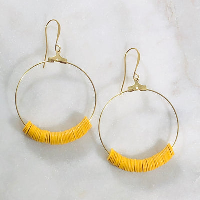 Handmade gold hoop earrings with mustard for a minimalist statement