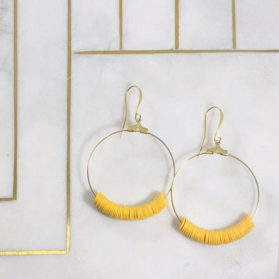 Handmade gold hoop earrings with mustard african vinyl discs