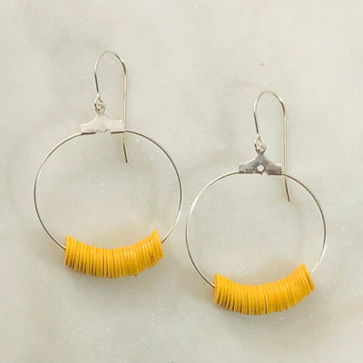 Handmade silver hoop earrings with mustard for a modern statement
