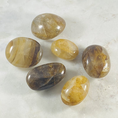 golden healer quartz palm stone by sarah belle