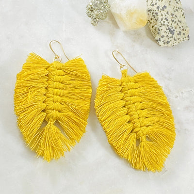 Handmade tropical leaf tassel statement earrings by Sarah Belle