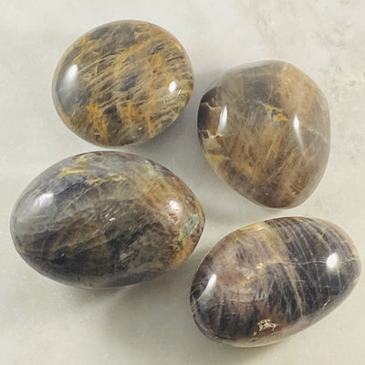 Black moonstone palm stone for meditation