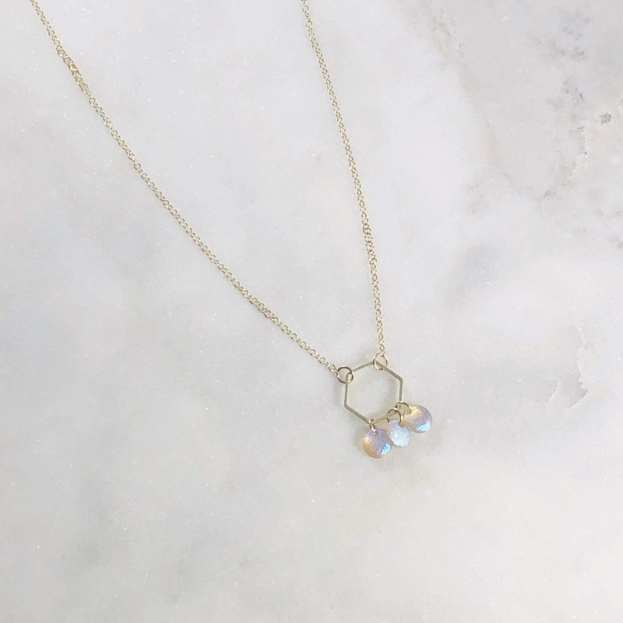 Unique handmade necklace with brass hexagon and czech glass to symbolize balance and shining your light