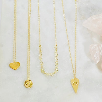 Handmade inspiring gold charm necklaces by Sarah Belle