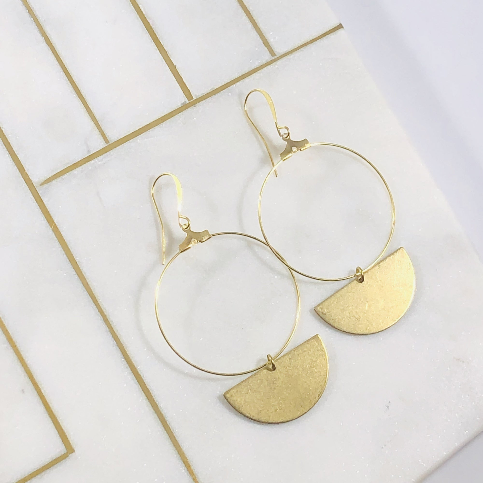Handmade gold hoop earrings that make a modern minimalist statement