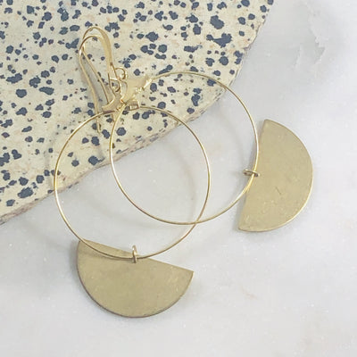Handmade gold hoop earrings with half moons for a modern minimalist statement