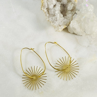 Handmade gold hoop earrings by Sarah Belle