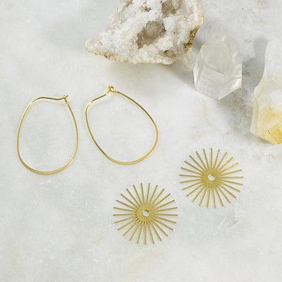 Versatile hoop earrings with removable charm by Sarah Belle