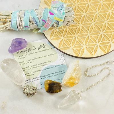 Healing crystals for manifesting, sage and crystal grid by Sarah Belle