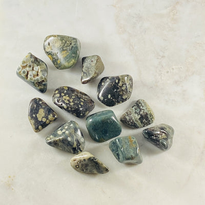 Ocean Jasper tumbled stone for grounding and healing crystal energy, useful for meditation.