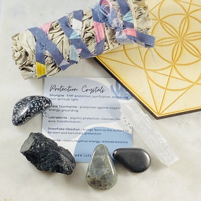Protection crystals, sage and crystal grid by Sarah Belle