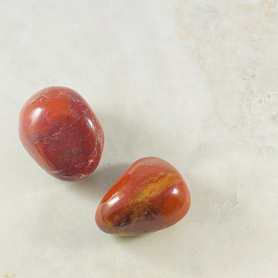 Red Jasper palm stone to empower the root chakra and for grounding energy.