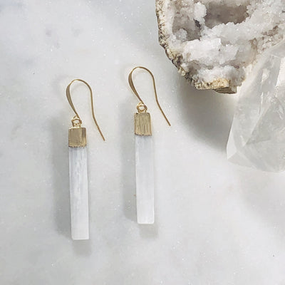 Crystal healing earrings with selenite for protecting against negativity
