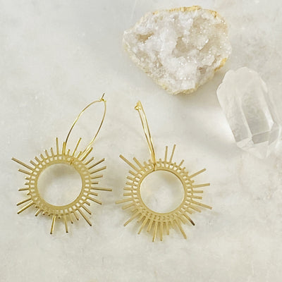 Gold plated hoop earrings with shine pendant by Sarah Belle