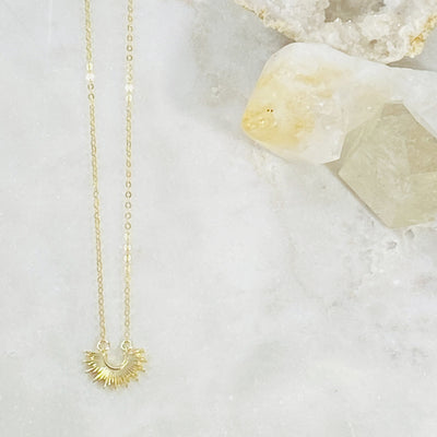 Handmade gold sol necklace symbolizing the sun