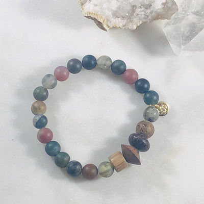 Handmade healing crystal jewelry for strength, grounding and balance