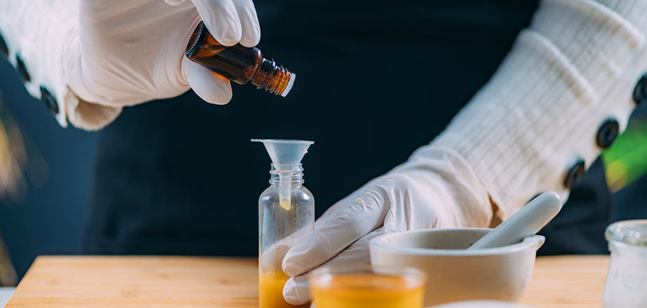 Pouring CBD oil in a bottle in a lab. buy cbd oil online.