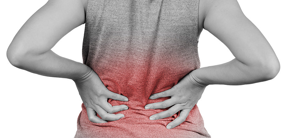 Woman showing signs of lower back pain and inflammation. cbd oil for chronic back pain. How to use cbd oil for pain. Will cbd oil help back pain? Does cbd oil help with back pain?