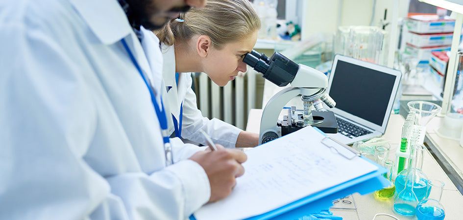 Lab workers doing CBD tests. Does cbd oil show up on a drug test? cbd and drug testing. Will cbd oil show up on a drug test? Will cbd oil show up in a urine test?