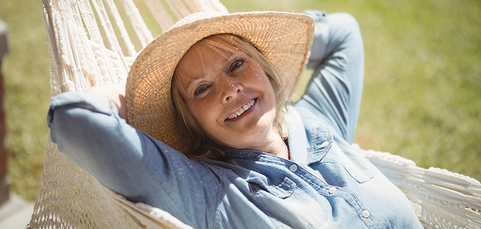 Adult woman relaxing on a hammock. cbd oil for chronic back pain. How to use cbd oil for pain. Will cbd oil help back pain? Does cbd oil help with back pain?