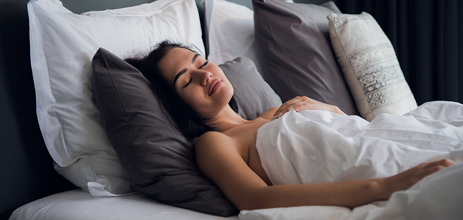 Woman sleeping soundly after using CBD oil.