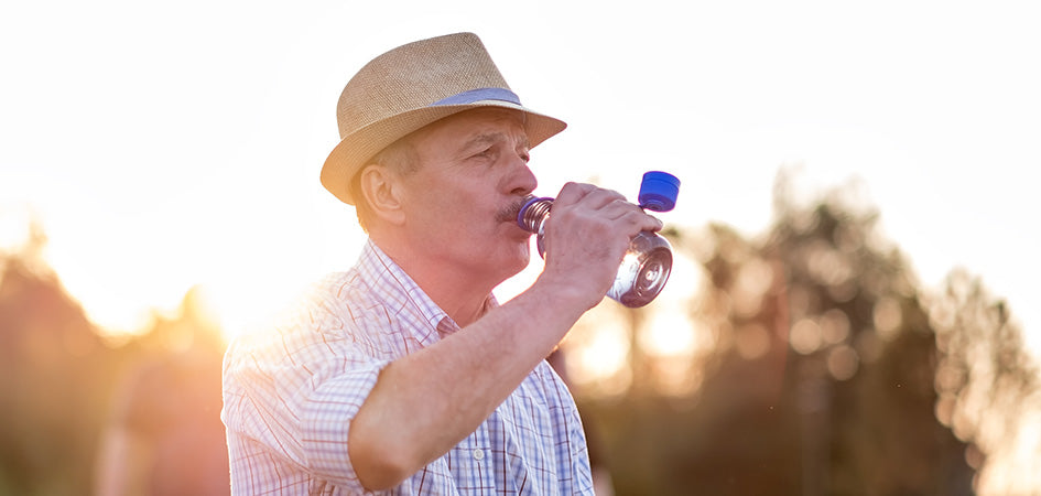 man drinking from water bottle. cbd for chronic back pain. cbd back pain. Is cbd oil good for back pain?