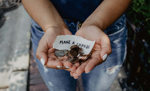 Make A Change - Woman holding coins