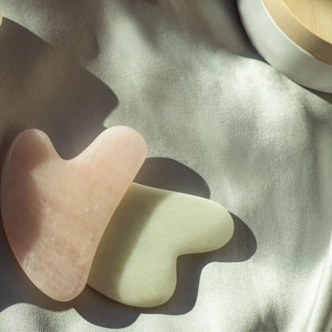 pink and green gua sha stones from Clean Beauty Swiss