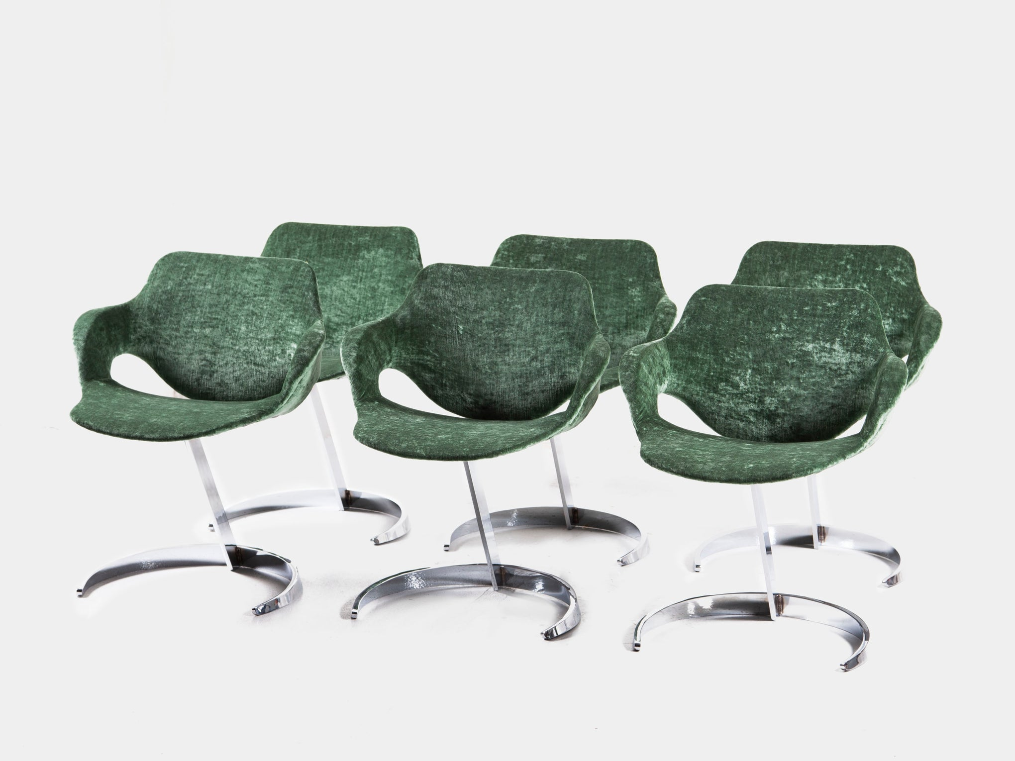 Lovely green Scimitar dining chairs by Boris Tabacoff