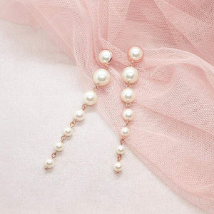 Rose Gold Caiti modern pearl drop earrings on pink