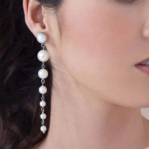 Silver Caiti modern pearl drop earrings from right