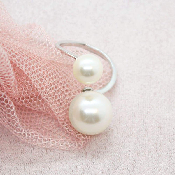 Ivory Calypso Modern Pearl Wrap Ring on pink