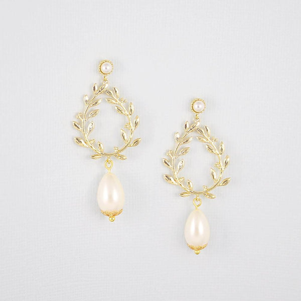 Gold Cassia Pearl Drop Bridal Earrings on grey