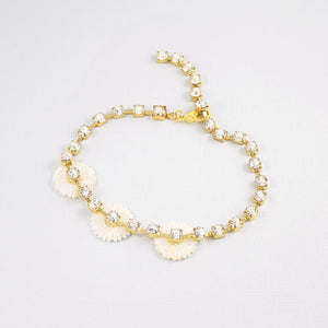 Gold Chloe Pearl & Crystal Daisy Bracelet on grey