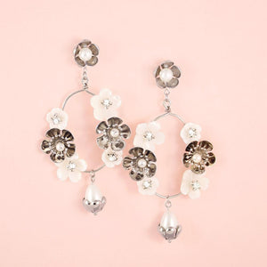 Silver Felicity Floral Bridal Earrings on pink